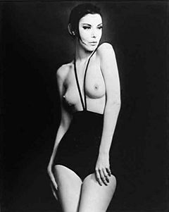 Peggy Moffit wearing a black Topless Swimsuit
